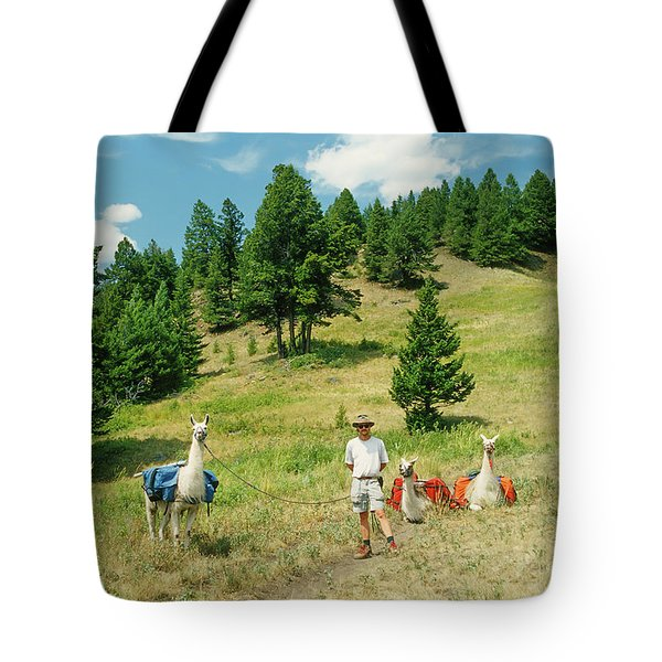 Man Posing With Llamas In A Beautiful Grassy Meadow Tote Bag by Jerry Voss