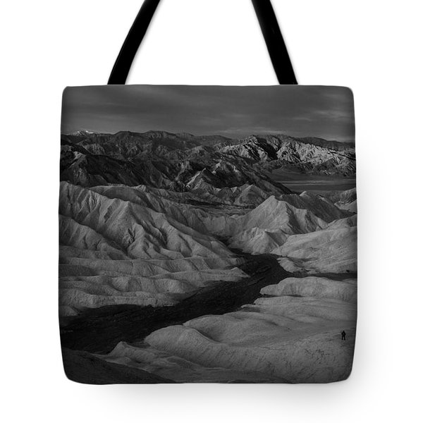 Man's Insignificance In Nature Bw Tote Bag
