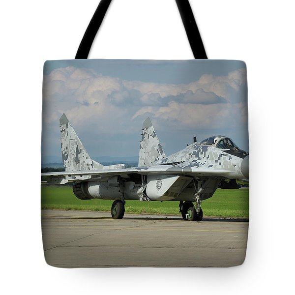 Tote Bag featuring the photograph Mikoyan-gurevich Mig-29as by Tim Beach