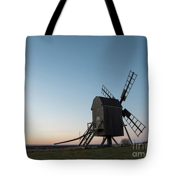 Tote Bag featuring the photograph Old Wooden Windmill By Evening Light by Kennerth and Birgitta Kullman