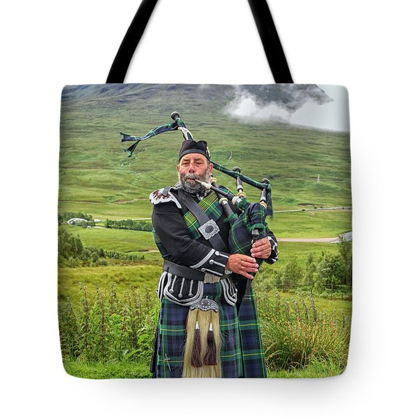 Playing Bagpiper Tote Bag