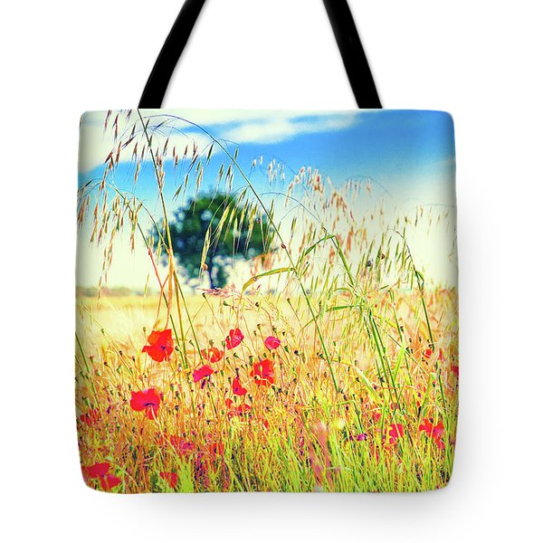 Tote Bag featuring the photograph Poppies With Tree In The Distance by Silvia Ganora