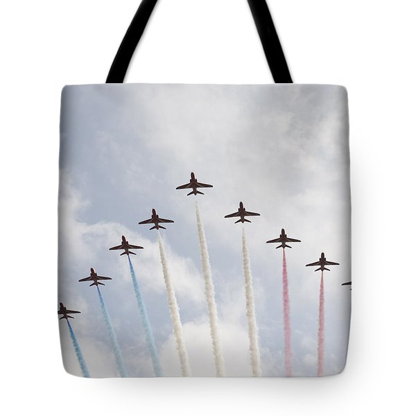 Tote Bag featuring the photograph Red Arrows by Christopher Rowlands