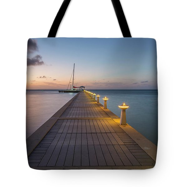 Tote Bag featuring the photograph Rum Point Pier At Sunset by Adam Romanowicz