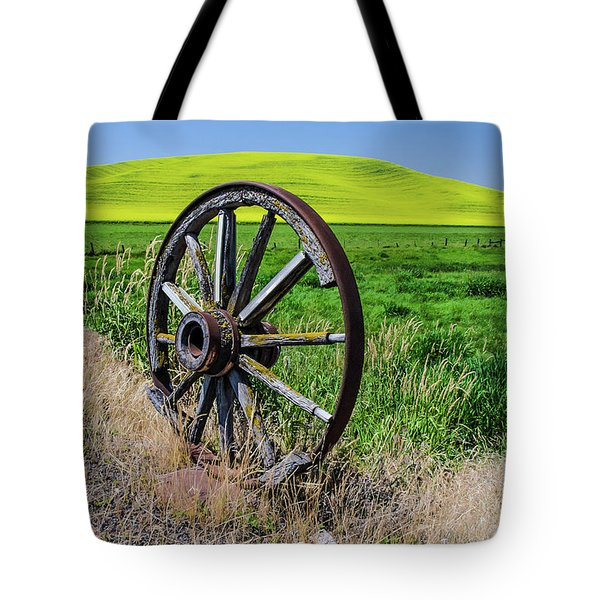 Rustic Wagon Wheel In The Palouse Tote Bag by James Hammond