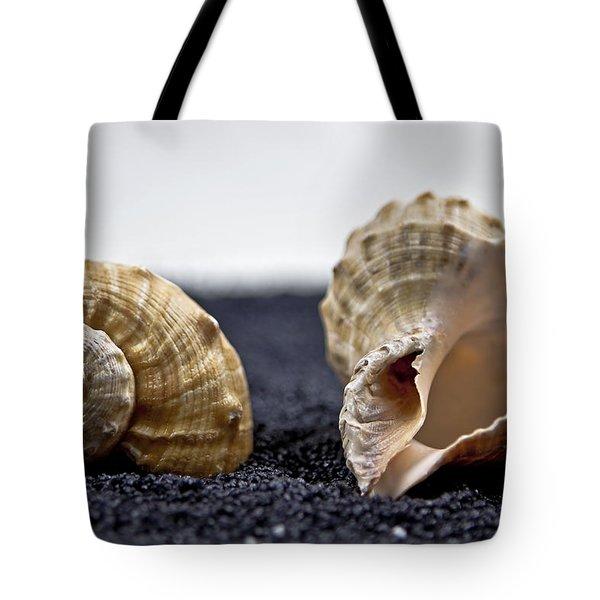 Seashells On Black Sand Tote Bag by Joana Kruse