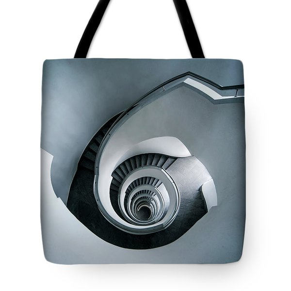 Tote Bag featuring the photograph Spiral Staircase In Blue Tones by Jaroslaw Blaminsky