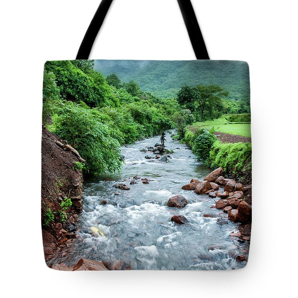 Tote Bag featuring the photograph Stream by Charuhas Images