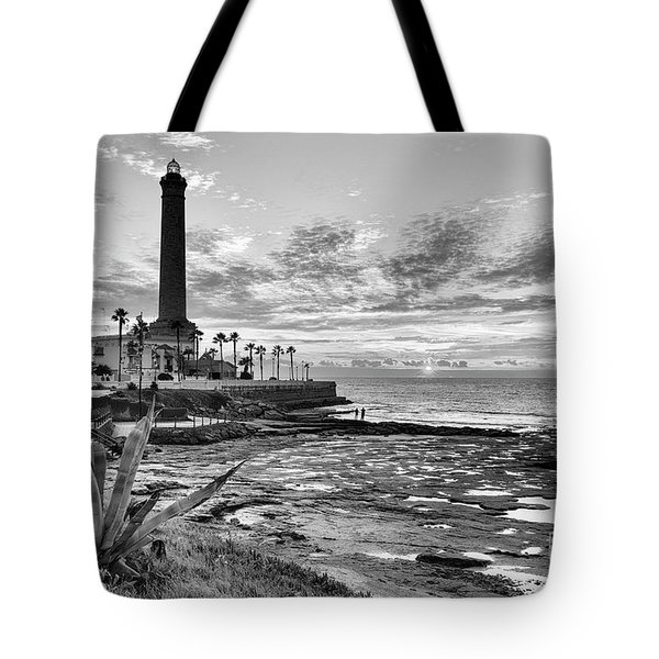 Tote Bag featuring the photograph Sunset At Chipiona Lighthouse Cadiz Spain by Pablo Avanzini