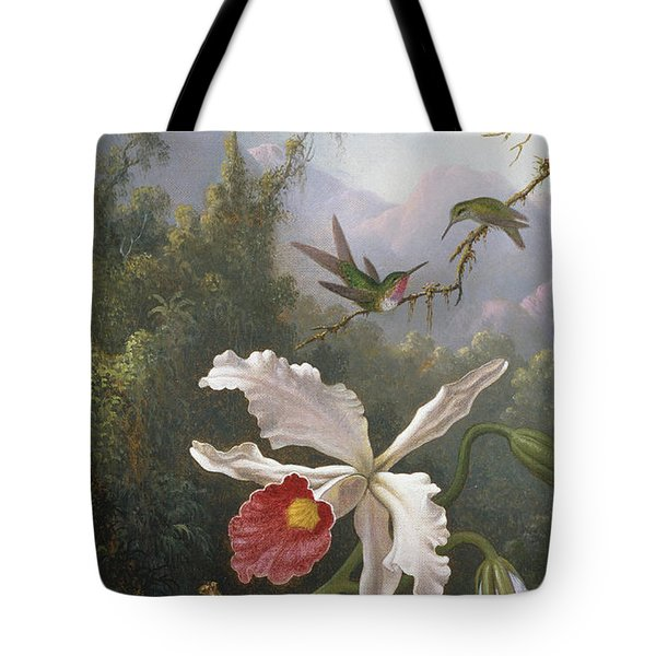 Two Hummingbirds Above A White Orchid Tote Bag