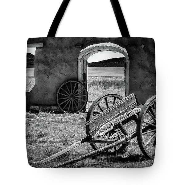 Wagon Wheels In Bw Tote Bag by James Barber