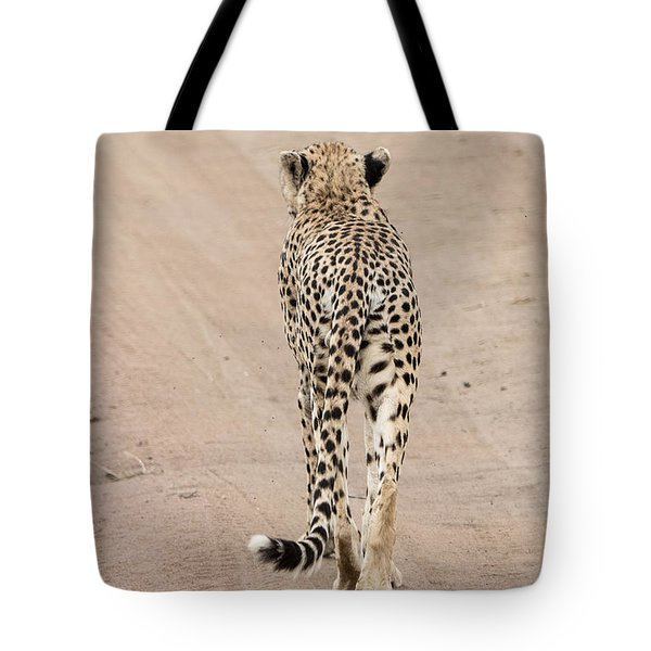 Tote Bag featuring the photograph Walking Away by Pravine Chester