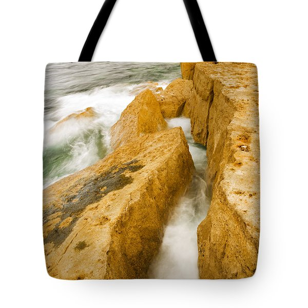Tote Bag featuring the photograph Waves Crashing Over Portland Bill by Ian Middleton