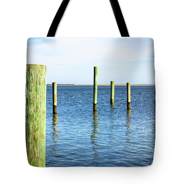 Tote Bag featuring the photograph Wood Pilings by Colleen Kammerer