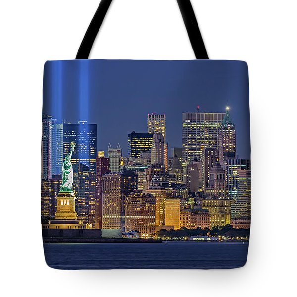 Tote Bag featuring the photograph World Trade Center Wtc Tribute In Light Memorial II by Susan Candelario