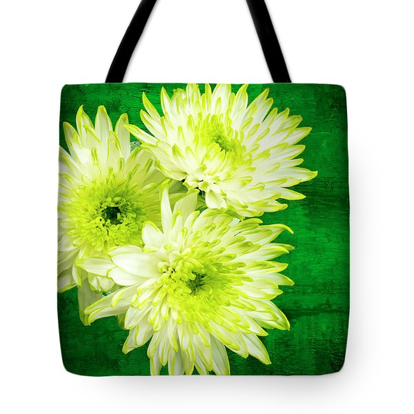 Yellow Chrysanthemums On A Green Background. Tote Bag by Paul Cullen