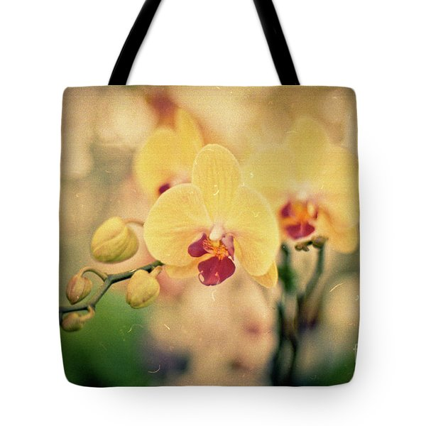 Tote Bag featuring the photograph Yellow Orchids by Ana V Ramirez