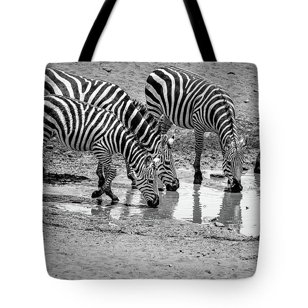 Tote Bag featuring the photograph Zebras At The Watering Hole by Marion McCristall