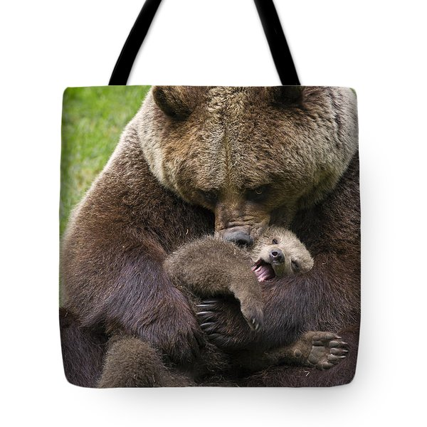 Mother Bear Cuddling Cub Tote Bag