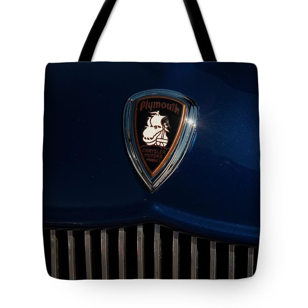 Tote Bag featuring the photograph 1930s Plymouth Head Badge by Chris Flees