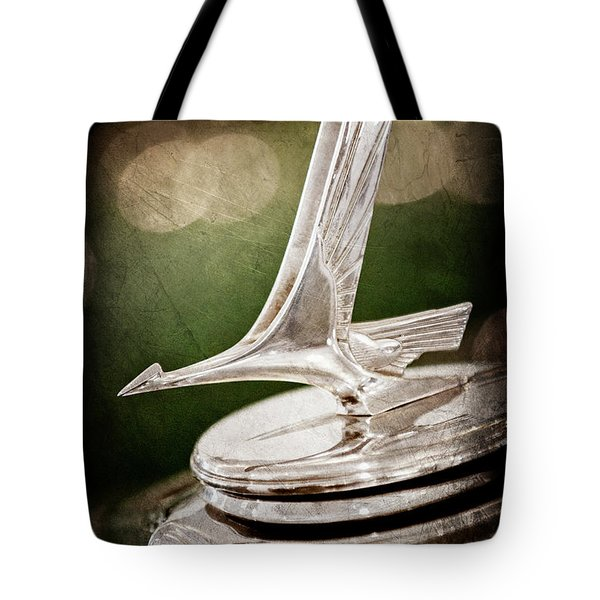 Tote Bag featuring the photograph 1932 Studebaker Dictator Hood Ornament -0850ac by Jill Reger