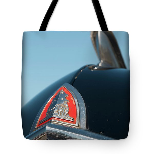 Tote Bag featuring the photograph 1947 Plymouth Head Badge by Chris Flees