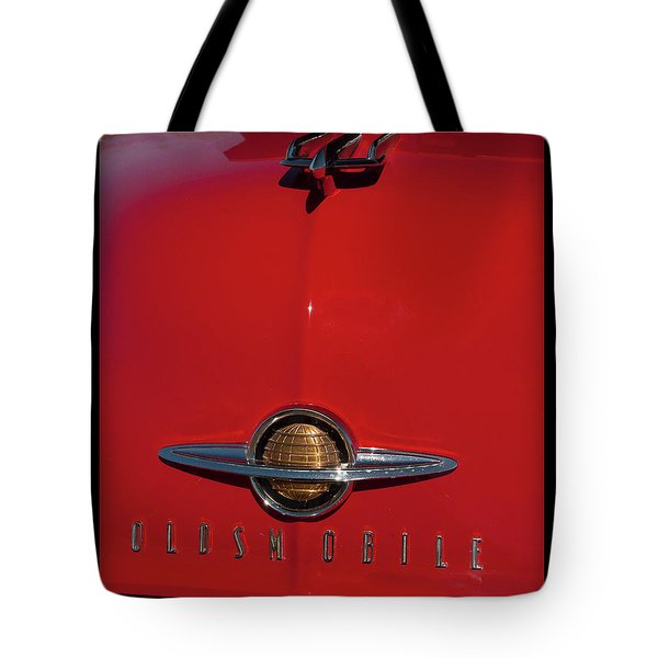 Tote Bag featuring the photograph 1950 Oldsmobile Head Badge And Hood Ornament by Chris Flees