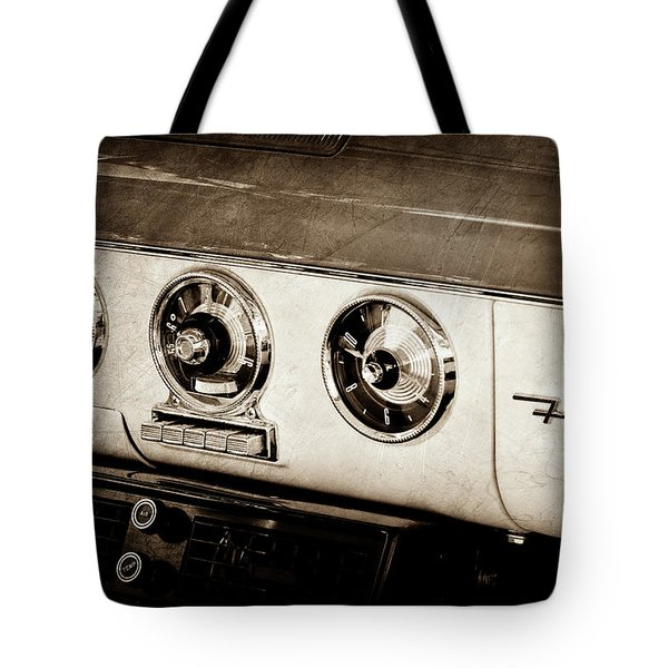 Tote Bag featuring the photograph 1955 Ford Fairlane Dashboard Emblem -0444s by Jill Reger