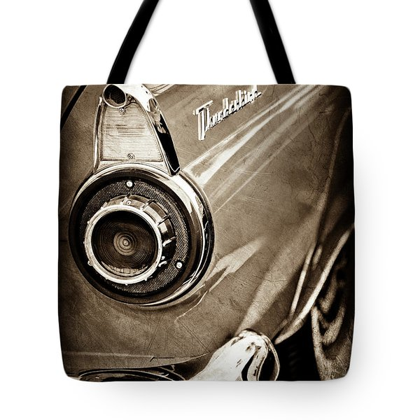Tote Bag featuring the photograph 1956 Ford Thunderbird Taillight Emblem -0382s by Jill Reger