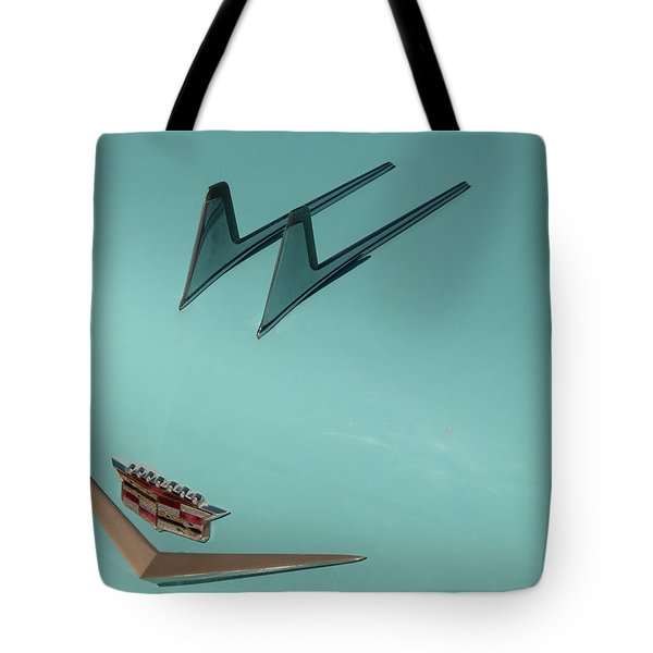 Tote Bag featuring the photograph 1957 Cadillac Twin Fin Hood Ornament by Chris Flees