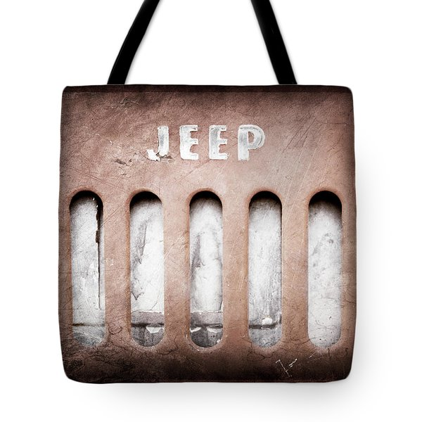 Tote Bag featuring the photograph 1957 Jeep Emblem -0597ac by Jill Reger