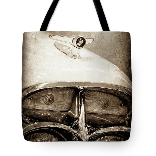 Tote Bag featuring the photograph 1957 Mercury Turnpike Cruiser Emblem -0749s by Jill Reger