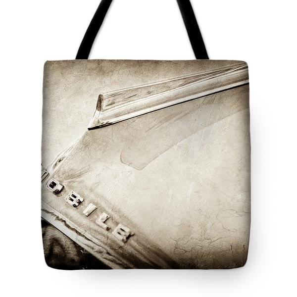 Tote Bag featuring the photograph 1962 Oldsmobile Hood Ornament And Emblem -0598s by Jill Reger