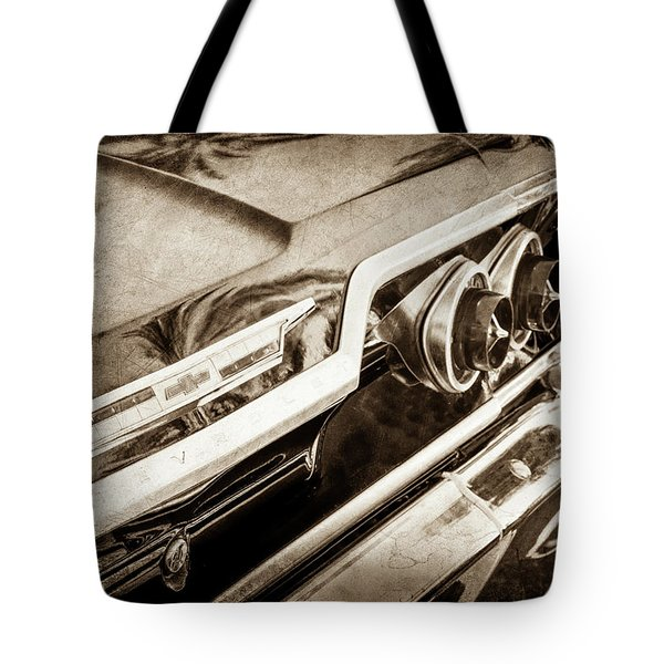 Tote Bag featuring the photograph 1963 Chevrolet Taillight Emblem -0183s by Jill Reger