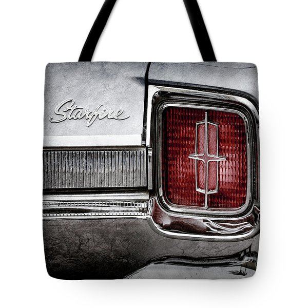Tote Bag featuring the photograph 1965 Oldsmobile Starfire Taillight Emblem -0212ac by Jill Reger