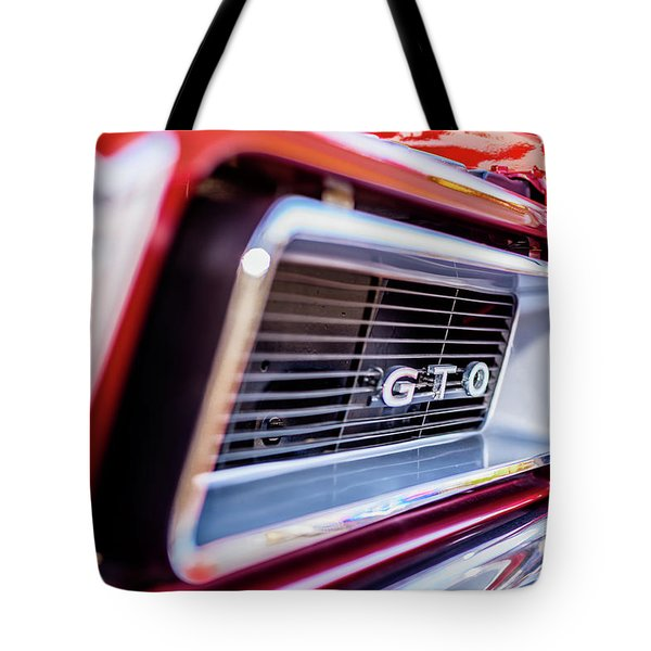 Tote Bag featuring the photograph 1965 Red Gto Grill by Aloha Art
