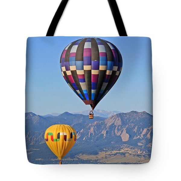 2 Balloons Flying Over The Flatirons Tote Bag by Scott Mahon