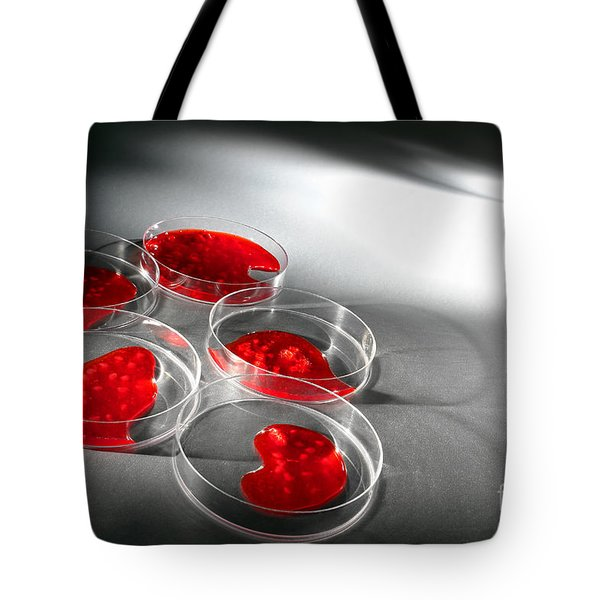 Tote Bag featuring the photograph Biotechnology Experiment In Science Research Lab by Olivier Le Queinec