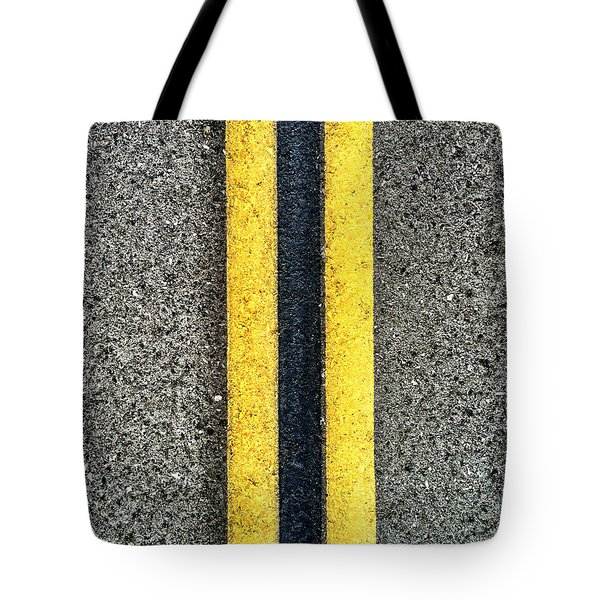 Tote Bag featuring the photograph Double Yellow Road Lines by Bryan Mullennix