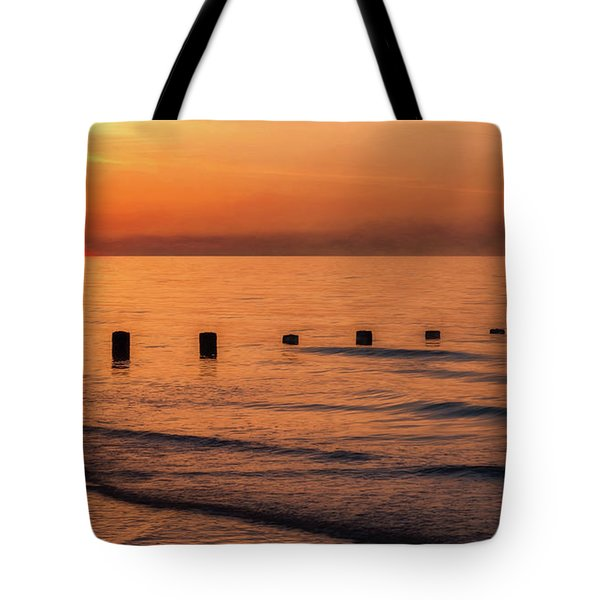 Tote Bag featuring the photograph Golden Sunset by Adrian Evans