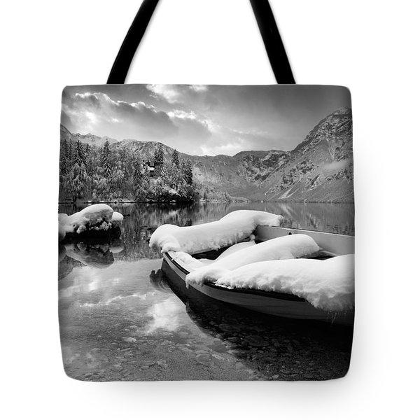 Snow Covered Boat On Lake Bohinj In Winter Tote Bag