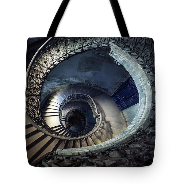 Tote Bag featuring the photograph Spiral Staircase With Ornamented Handrail by Jaroslaw Blaminsky