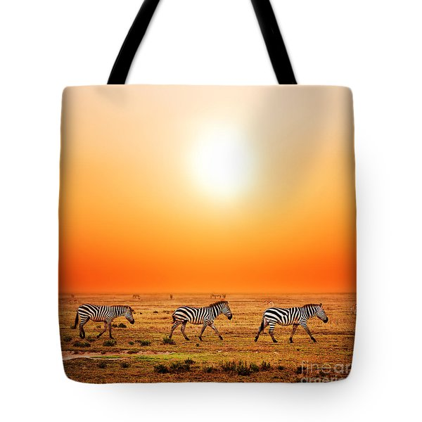 Zebras Herd On African Savanna At Sunset. Tote Bag