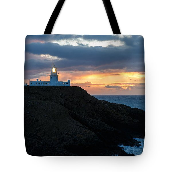 Tote Bag featuring the photograph Sunset At Strumble Head Lighthouse by Ian Middleton