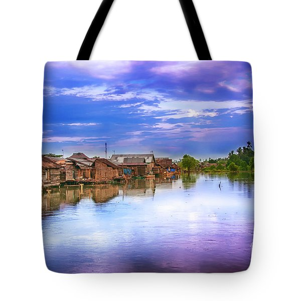 Tote Bag featuring the photograph Village by Charuhas Images