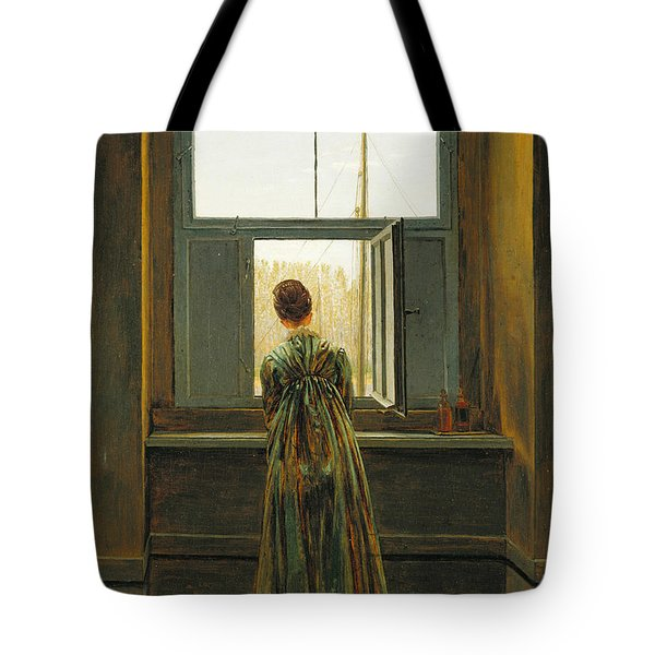 Woman At A Window Tote Bag