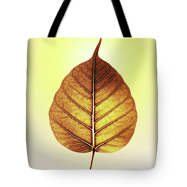 Tote Bag featuring the photograph Pho Or Bodhi by Atiketta Sangasaeng