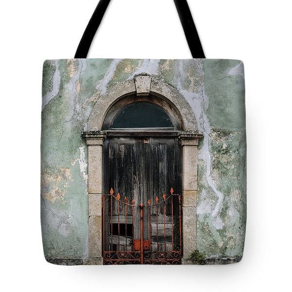 Tote Bag featuring the photograph Door With No Number by Marco Oliveira