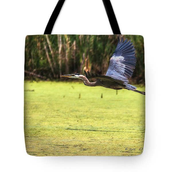 Tote Bag featuring the photograph Great Blue Heron In Flight by Edward Peterson