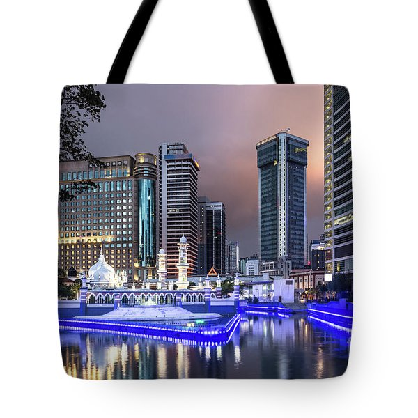 The Office Buildings Reflects In The Water Of The Klang River In Tote Bag